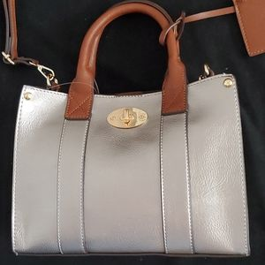 Pewter two in one purse. Handle and crossbody.